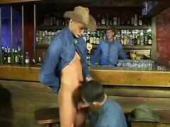 Hot cowboys fuck in bar
