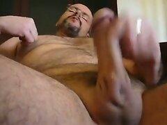 Bearded gay bear makes himself cum intensively