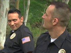 Lecherous gay cops have fun outdoors