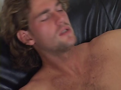 Three hunky dudes fuck bareback on the sofa