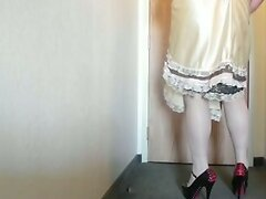 Sissy Ray in Gold Sissy Dress and black and red heels