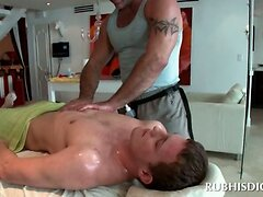 Gay masseur giving oil body massage to hot guy