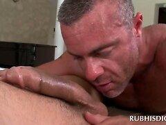 Aroused gay masseur deep throating big loaded penis