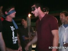 Blindfolded college boys in gay fraternity ritual