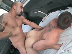 Tattooed dudes ass banging on the sex bus floor