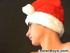 Twink in Santa hat strokes his cock