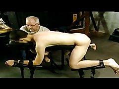 BDSM bondage gay boy is whipped and milked