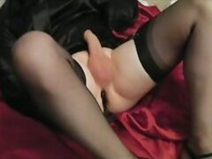 Crossdresser cd cums with sex toy with black nylon stockings