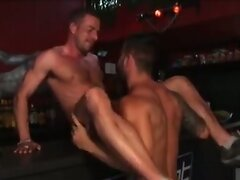 Muscle bears in a bar