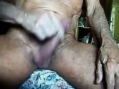 Mature guy plays with cock