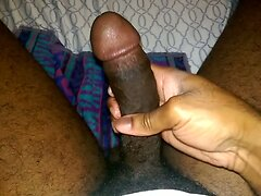 Solo black cock stroking