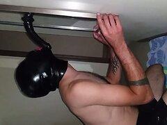 Rubberman sucks dildo with condom hood