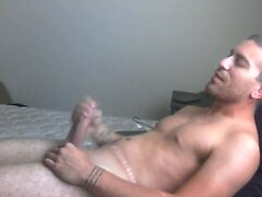 Stroking his hard cock until he is worn out