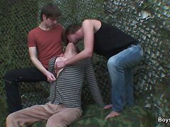 Homosexual anal DP in front of a camouflage net