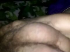 Playing with soft hairy cock