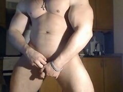 Very handsome muscular man posing and jerking off