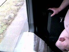 Trucker masturbating in the truck at the window