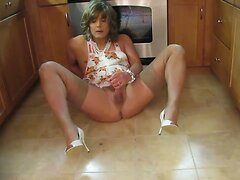 Sexy Crossdresser Plays In The Kitchen