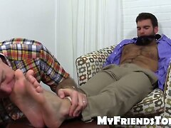 Chase is gagged for foot adornment