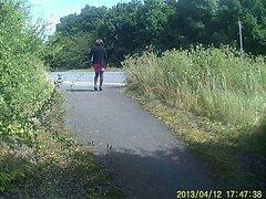 Crossdressed in black stockings in public path by road