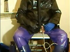Pissing and wanking in piss soaked rubber.