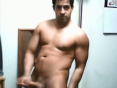 Sexy muscular guy stroking his big dick