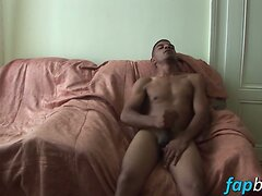 Latino hunk plays with his giant boner