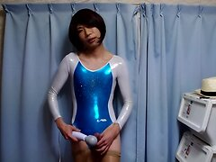crossdresser in blue and white metallick leotard