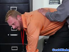Muscular stud pounds bloke on office desk