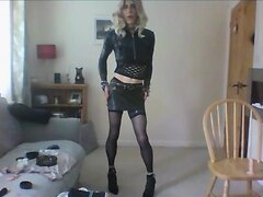 A girl in leather and stockings