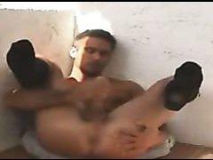 Tanned man in socks masturbates