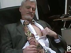 Horny mature man jerks off in the office