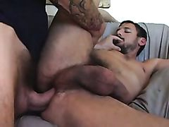 Hot tattooed stud fucks his bearded friend