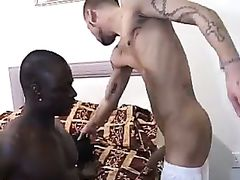 Muscled black hunk drills lusty tattooed white dude