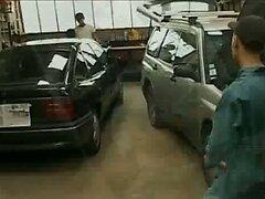 3 mechanics in garage